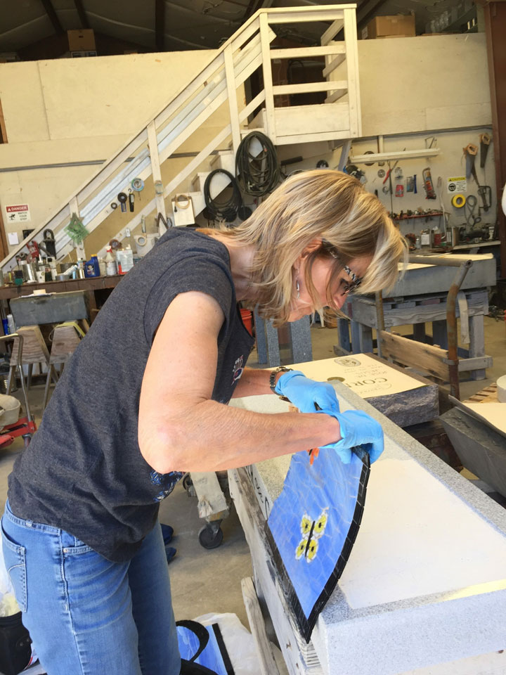 Marsha working on a butterfly mosaic tile
